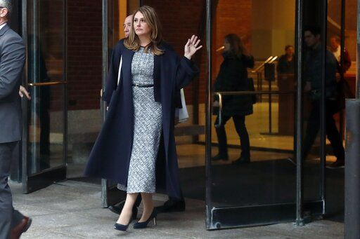 Michelle Janavs leaves federal court, Tuesday, Feb. 25, 2020, in Boston, after being sentenced to five months in prison for trying to cheat and bribe her daughters' way into college as part of a nationwide college cheating scam.