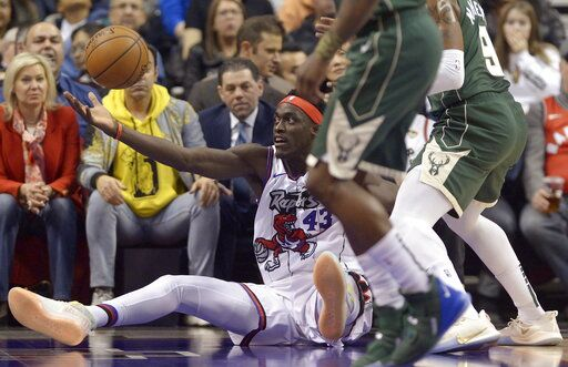 Toronto Raptors forward Pascal Siakam (43) falls as he tries to grab the ball during the first half of the team's NBA basketball game against the Milwaukee Bucks Tuesday, Feb. 25, 2020, in Toronto. (Nathan Denette/The Canadian Press via AP)