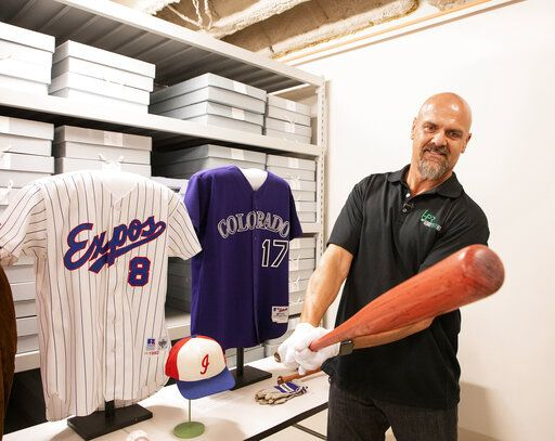 "In this photo provided by the National Baseball Hall of Fame and Museum, Larry Walker swings a bat he used during his 1997 National League MVP season, Tuesday, Feb. 25, 2020 at the National Baseball Hall of Fame in Cooperstown, N.Y. Walker said on Tuesday that his Hall of Fame plaque will show him in Colorado Rockies cap, not a Montreal Expos hat. He added the key to picking the Rockies is that Colorado was ""where the majority of my damage was done."" (Milo Stewart, Jr./National Baseball Hall of Fame and Museum via AP)"
