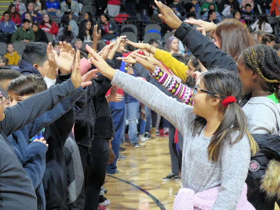 Some students were lucky enough to form a high-five chain when players were introduced for the Windy City Bulls game on Feb. 20.