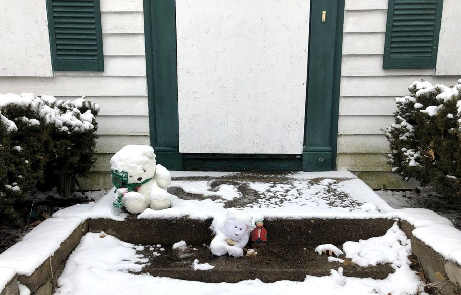 Stuffed animals remain on the front porch of this house at 94 Dole Ave. in Crystal Lake, where authorities allege 5-year-old AJ Freund was killed by his parents last April.