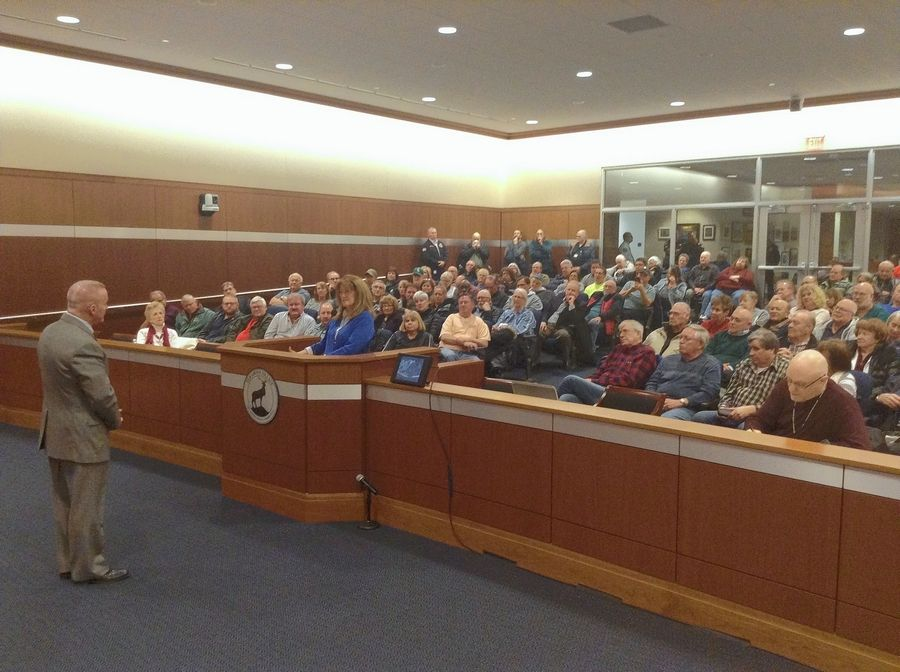 More than 200 residents filled the Elk Grove Village council chambers and an adjoining meeting room for a town hall meeting Wednesday night. Most of the attendees were supporters of Mayor Craig Johnson and current village board members.