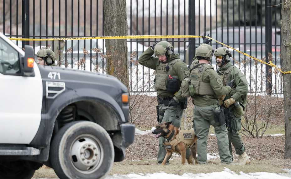 Police work Wednesday outside the Molson Coors Brewing Co. campus in Milwaukee after an employee opened fire Wednesday, killing five fellow workers before taking his own life.