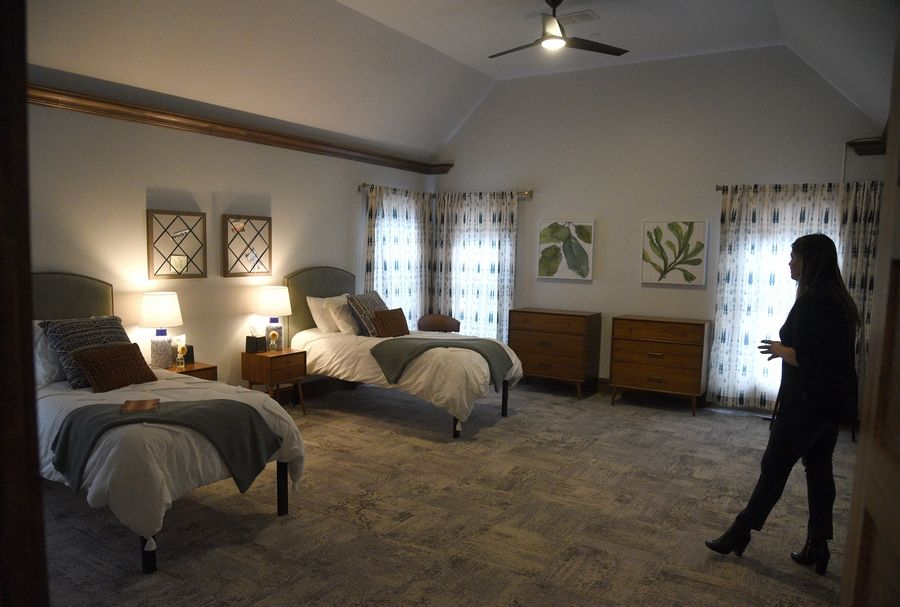 Carrie Hunnicutt shows off one of the bedrooms during a tour Friday of Monte Nido Chicago, a new eating disorders treatment center set to open Monday in Winfield.