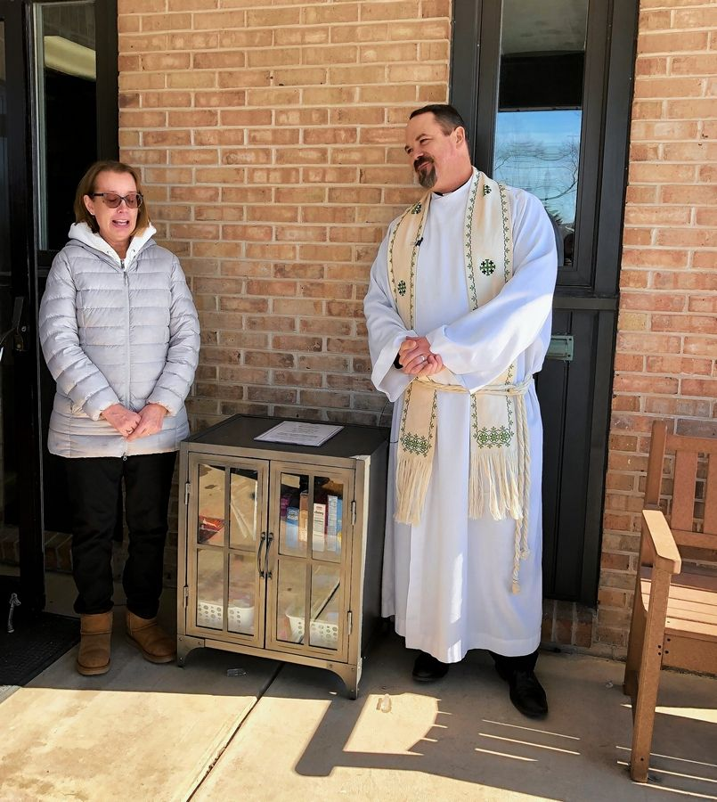 Nancy Chapdelaine and the Rev. Timothy Seitz attend the dedication of the micro-free pantry at Prince of Peace Lutheran Church on Sunday, Feb. 16.