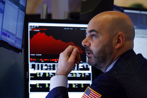 Trader Fred DeMarco works on the floor of the New York Stock Exchange, Friday, Feb. 28, 2020. Global stock markets are falling further on spreading virus fears.