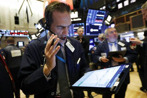 Trader Gregory Rowe works on the floor of the New York Stock Exchange, Friday, Feb. 28, 2020. Stocks are opening sharply lower on Wall Street, putting the market on track for its worst week since October 2008 during the global financial crisis.