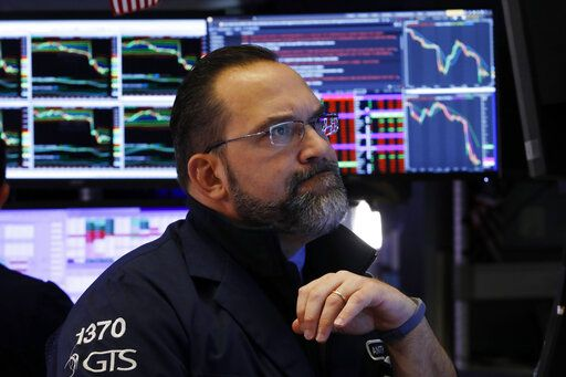 Specialist Anthony Matesic works at his post on the floor of the New York Stock Exchange, Friday, Feb. 28, 2020. Stocks are opening sharply lower on Wall Street, putting the market on track for its worst week since October 2008 during the global financial crisis.