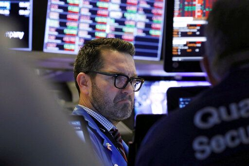 Trader Leon Montana works on the floor of the New York Stock Exchange, Friday, Feb. 28, 2020. Stocks are opening sharply lower on Wall Street, putting the market on track for its worst week since October 2008 during the global financial crisis.