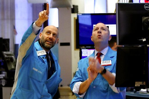 Specialists Meric Greenbaum, left, and Jay Woods work on the floor of the New York Stock Exchange, Friday, Feb. 28, 2020. Stocks are opening sharply lower on Wall Street, putting the market on track for its worst week since October 2008 during the global financial crisis.