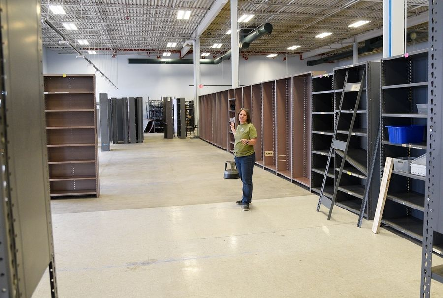 Bev Jaszczurowski, chief operating officer of the environmental education nonprofit SCARCE, shows off new shelving and larger space at a new facility at 800 Rohlwing Road in Addison, where the organization plans to be open March 14.