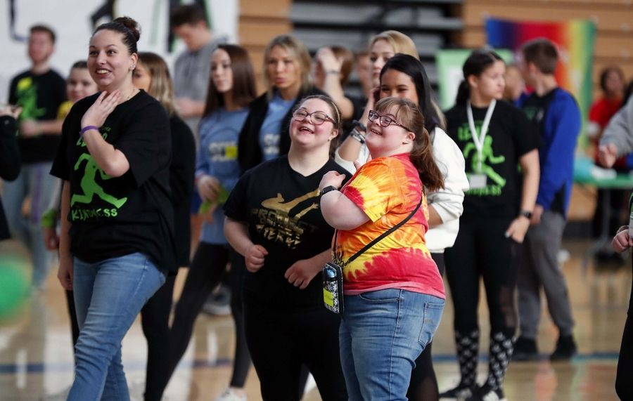 "Sophia Spizzirri, 19, left, and Lilly Washko, 21, both of St. Charles put on some moves as Team Polaris and St. Charles North hosted ""Project Dance Leap"" Saturday at St. Charles North High School. The four-hour dance party promotes awareness and raises funds for local organizations that provide services for individuals with special needs."