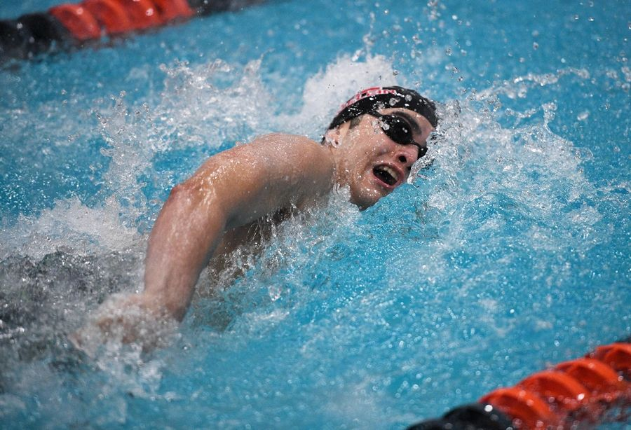 Mundelein's Omar Fathallah competes in the 100-yard freestyle at the IHSA state boys swimming final in Evanston on Saturday.