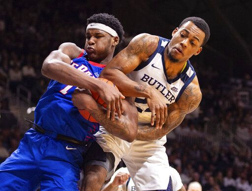 DePaul forward Romeo Weems, left, and Butler forward Markeese Hastings, right, battle for a rebound during the second half of an NCAA college basketball game, Saturday, Feb. 29, 2020, in Indianapolis.