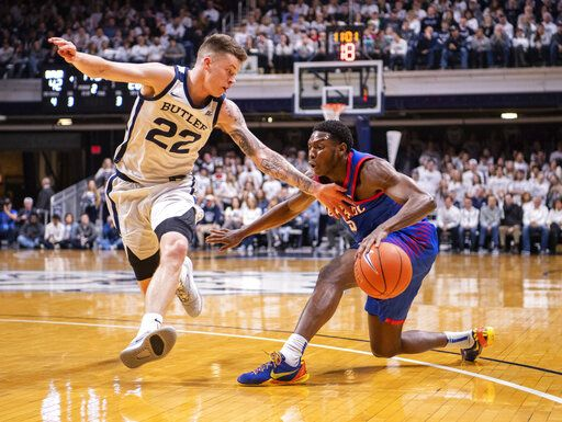 Butler forward Sean McDermott (22) forces DePaul guard Jalen Coleman-Lands (5) to stop his drive to the basket during the second half of an NCAA college basketball game, Saturday, Feb. 29, 2020, in Indianapolis.