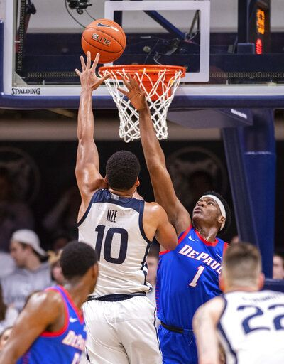 DePaul forward Romeo Weems (1) tries to block the shot of Butler forward Bryce Nze (10) during the second half of an NCAA college basketball game, Saturday, Feb. 29, 2020, in Indianapolis.