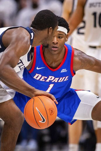 DePaul forward Romeo Weems (1) watches the ball while Butler guard Kamar Baldwin (3) works it around the court during the second half of an NCAA college basketball game, Saturday, Feb. 29, 2020, in Indianapolis.