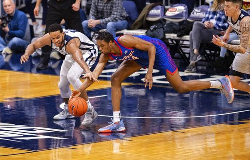 Butler forward Bryce Nze (10), left, and DePaul center Nick Ongenda (14) battle for the ball during the second half of an NCAA college basketball game, Saturday, Feb. 29, 2020, in Indianapolis.