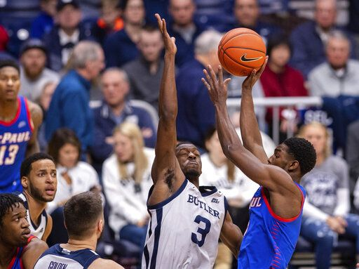 Butler guard Kamar Baldwin (3) tries to block the shot of DePaul guard Jalen Coleman-Lands (5) during the second half of an NCAA college basketball game, Saturday, Feb. 29, 2020, in Indianapolis.