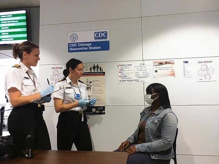Courtesy of Centers for Disease ControlA traveler is checked for illness at O'Hare International Airport's quarantine station.