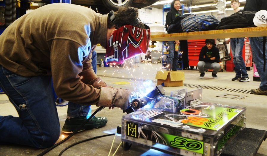 Fremd High School senior Justin Lilliebridge makes a weld repair to his team's robot while working in the auto shop area during the Robot Rumble at Prospect High School in Mount Prospect.