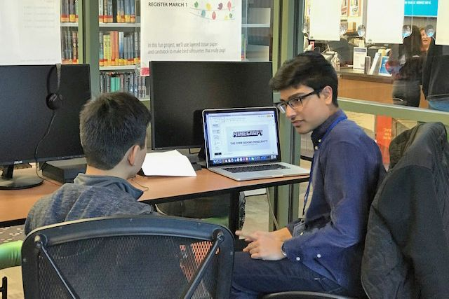 Conant High School student Rayaan Siddiqi teaches coding during a Tech Bytes session at the Hanover Park Branch Library. These free after-school sessions take place at the Hanover Park and Hoffman Estates branch libraries.