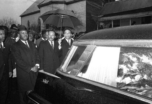 FILE - In this March 1, 1965, photo, the Rev. Martin Luther King Jr. leads a procession behind the casket of Jimmie Lee Jackson during funeral rites at Marion, Ala. From left, John Lewis, the Rev. Ralph Abernathy, King and the Rev. Andrew Young. In 1965, Jackson was fatally shot at a protest in Marion. It was that killing that sent hundreds of people to Selma for a march at the Edmund Pettus Bridge two weeks later.