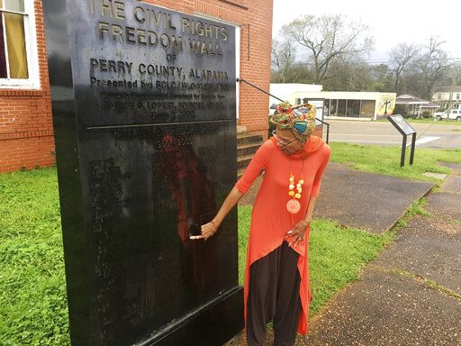 In this Feb. 18, 2020, photo, Della Simpson'¯Maynor'¯finds her name and her siblings names on a monument erected for people who marched and fought for voting rights in Marion, Ala. Maynor'¯remembers the'¯mounted'¯police officer cracking her elbow with a baton. She recalls the panicked marchers'¯unable to escape the onslaught, and the scuffle between officers and a young church deacon who was trying to '¯protect his mother and grandfather.'¯