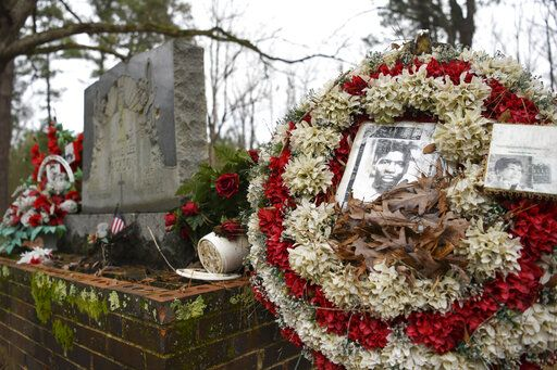 In this Feb. 16, 2020, photo, wreaths and mementos adorn the grave of Jimmie Lee Jackson at Heard Cemetery in Marion, Ala. In 1965, in what has become a footnote to history, Jimmie Lee Jackson was fatally shot at a protest in Marion. It was that killing that sent hundreds of people to Selma for a march at the Edmund Pettus Bridge two weeks later.