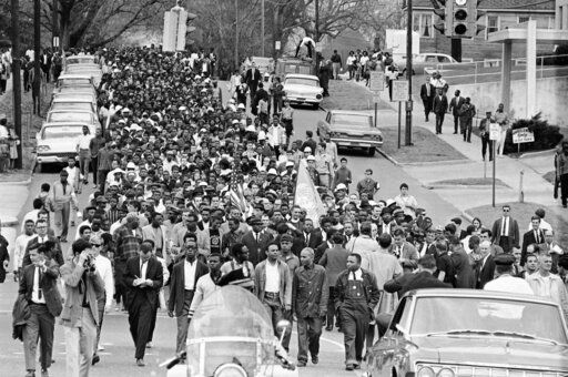 FILE - In this March 17, 1965, file photo, demonstrators walk to the courthouse behind the Rev. Martin Luther King Jr. in Montgomery, Ala. The march was to protest treatment of demonstrators by police during an attempted march. At front and center of march in white shirt is Andrew Young.