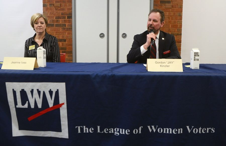 "Gordon ""Jay"" Kinzler answers a question while seated beside Jeanne Ives during the League of Women Voters candidate forum featuring candidates for the Republican nomination for the 6th Congressional District at the Barrington Area Library Saturday."