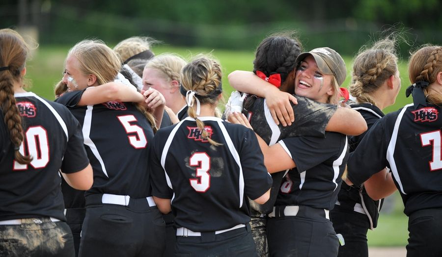 Victoria Schulte and Bri Bower hug after Huntley's Class 4A state title win over St. Charles East last June. Both players are back this year along with several of the Saints' key starters from that game.