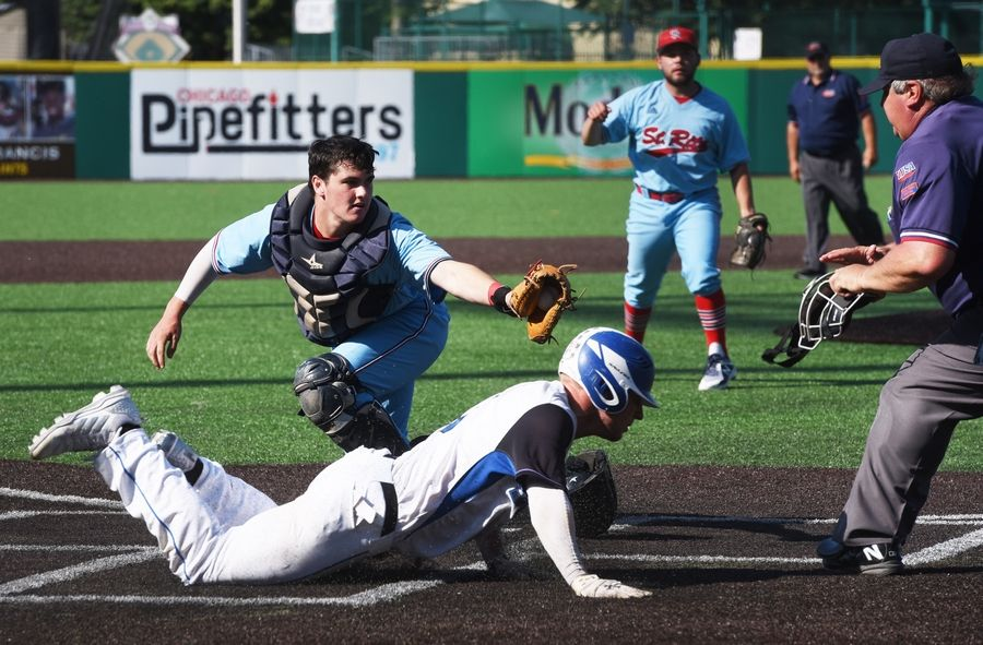 St. Charles North's Ryan Thiesse slides safely home during the North Stars' win over St. Rita in last year's Class 4A state semifinals.