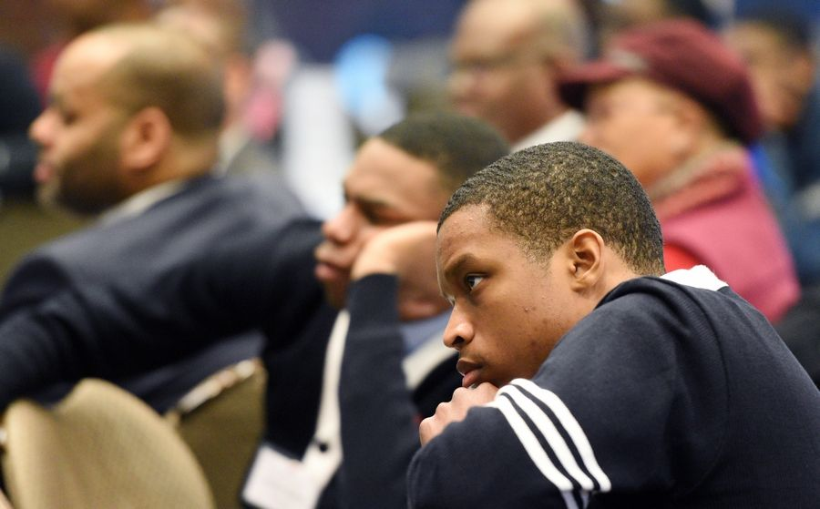 Anthony Gholston, Jr. from Triton College listens to J. Luke Wood during Elgin Community College's first Men of Color summit dealing with equity in education and the experiences of men of color at community colleges earlier this month.