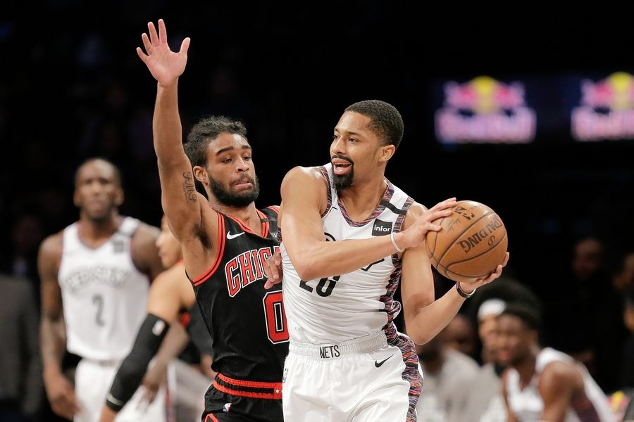 Brooklyn Nets' Spencer Dinwiddie, right, looks to pass around Chicago Bulls' Coby White during the first half of an NBA basketball game at the Barclays Center, Sunday, March 8, 2020, in New York.