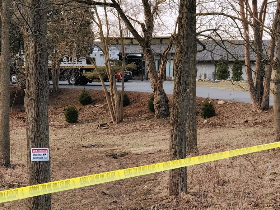 Yellow police tape surrounded a Barrington Hills home Sunday morning as police continue to investigate a deadly shooting there during a house party early Saturday morning.