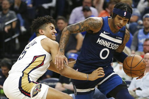 Minnesota Timberwolves' D'Angelo Russell, right, handles the ball around the defense of New Orleans Pelicans' Frank Jackson in the first half of an NBA basketball game Sunday, March 8, 2020, in Minneapolis.