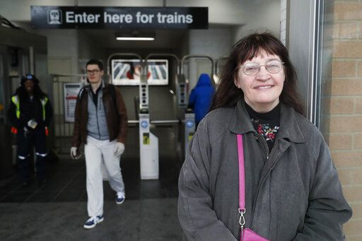"Playwright Vicki Quade poses for a portrait at the North & Clybourn Streets ""L"" station Monday, March 9, 2020, in Chicago. Older adults, those 60 and up like Quade should avoid crowds, cruises and long plane trips to avoid the coronavirus, advice that one public health official acknowledged won't be welcomed by many. Quade, 66, said she thinks most of the advice is extreme. ""Yes, be a bit more cautious, wash your hands and if you're not feeling good, stay inside,"" ""I'm not that worried. Perhaps I should be but I think we have to continue just living our lives,"" Quade said."