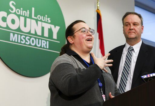 St. Louis County Public Health Department co-director Spring Schmidt, left, answers a question from the media as St. Louis County Executive Sam Page listens during a news conference to provide an update on local coronavirus cases at the Office of Emergency Management in Baldwin, Mo., Monday, March 9, 2020. The process of determining who needs to be notified, checked for symptoms and tested is unfolding, said Schmidt, acting co-director of the county health department. (Colter Peterson/St. Louis Post-Dispatch via AP)