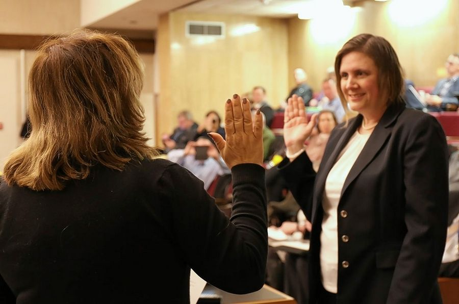 Buffalo Grove resident Marah Altenberg, right, is sworn in Tuesday to represent the 20th District on the Lake County Board and Lake County Forest Preserve District.