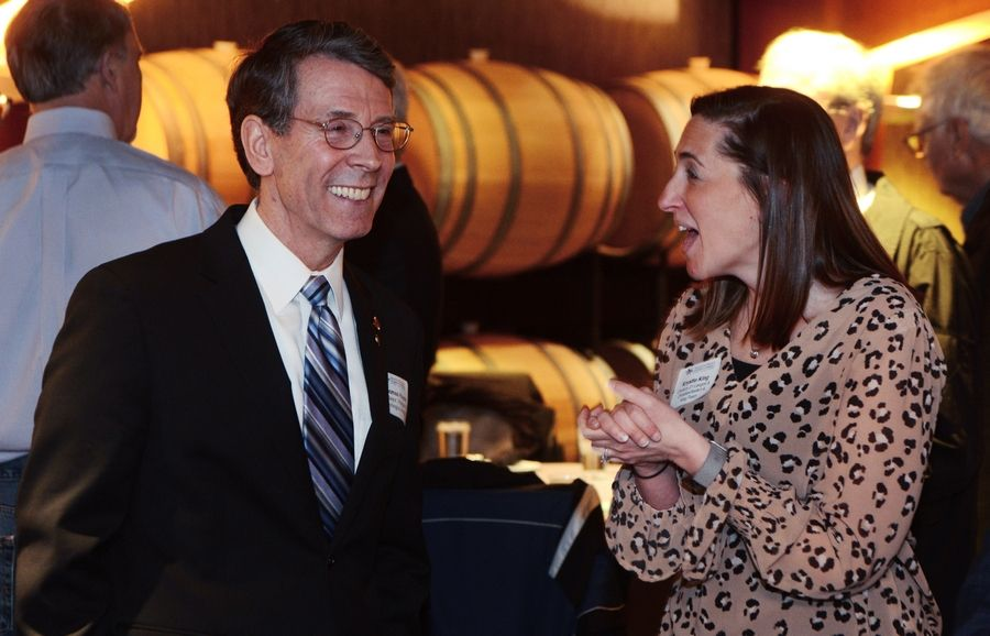 Arlington Heights Mayor Tom Hayes chats with Krystle King of Century 21 before delivering his State of the Village address Thursday during a Rotary Club luncheon.