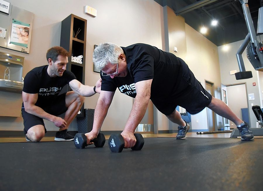 2020 Daily Herald Fittest Loser contestant and reporter Dick Quagliano with trainer Joshua Steckler at Push Fitness in Schaumburg.