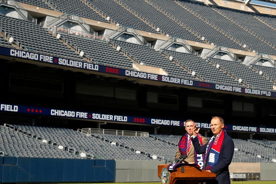 Fire owner Joe Mansueto, right, announces Oct. 8 that the MLS soccer team will play its 2020 season in Soldier Field as Chicago Parks Superintendent Michael P. Kelly listens. More than 30,000 tickets were sold for the Fire's March 21 home opener, but those empty seats won't fill up anytime soon as the COVID-19 pandemic has delayed the MLS season until at least April 8.