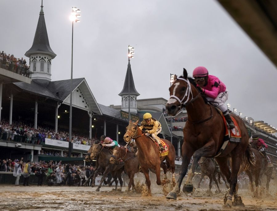 FILE -- In this May 4, 2019, file photo, Luis Saez rides Maximum Security, right, across the finish line first against Flavien Prat on Country House during the 145th running of the Kentucky Derby horse race at Churchill Downs in Louisville, Ky. Citing unidentified sources close to the race, the Courier-Journal of Louisville said Churchill Downs will postpone the Derby from May 2, 2020, to Sept. 5, making it the first time in 75 years that the race won't be run on the first Saturday in May.