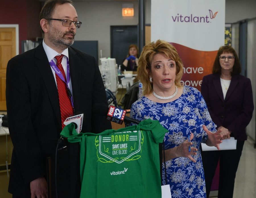Margaret Vaughn, government affairs director for the Illinois Coalition of Community Blood Centers, right, and Dr. Jason Krane, medical director of Vitalant, during a news conference Thursday at the Vitalant Blood Donation Center in Schaumburg urging residents to donate blood.