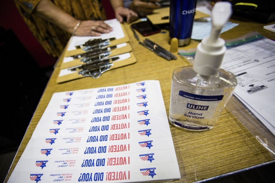 Hand sanitizer and stickers were the order of the day for voters at polling places for primaries in the city, suburbs and throughout the state Tuesday.