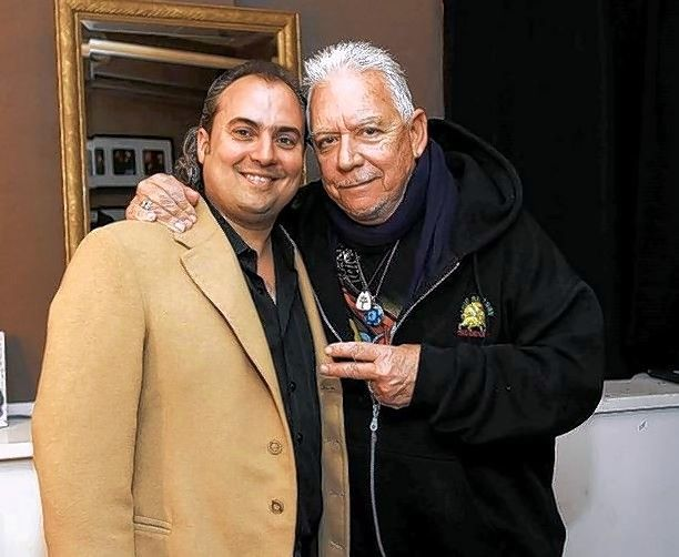 "Ron Onesti, left, with Eric Burdon, lead singer of the Animals, whose song ""We Gotta Get Out Of This Place"" became a Vietnam-era anthem."
