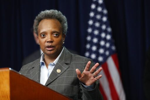 Chicago mayor Lori Lightfoot responds to a question after Illinois Gov. J.B. Pritzker announced a shelter in place order to combat the spread of the Covid-19 virus, during a news conference Friday, March 20, 2020, in Chicago.