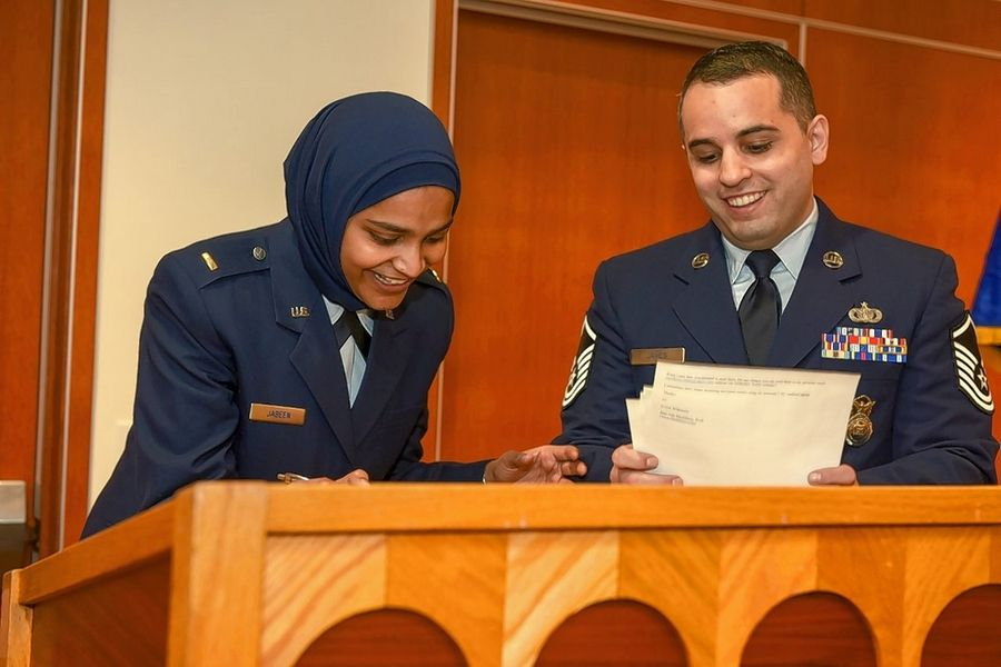 Second Lt. Saleha Jabeen, chaplain candidate, and Master Sgt. Alexander James, recruiter, sign recruitment paperwork after Jabeen's commissioning ceremony in December at the Catholic Theological Union in Chicago. Jabeen is the first female Muslim chaplain in the Air Force and Department of Defense.