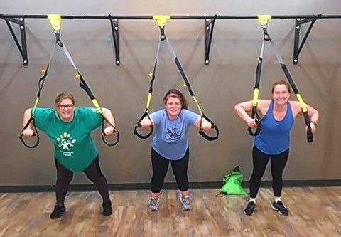 "Danielle Valentin, Lisa McQueen, and Joanna Wildhart from the Arlington Heights team ""Transformers"" tried out some TRX workouts during a boot camp at Push Fitness in Schaumburg."